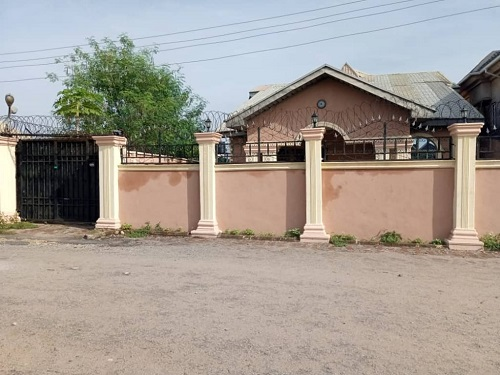 A  7 bedroom bungalow, 4 rooms down and 3 rooms paint house located at IMO housing close to the police station for sale