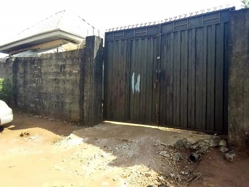 fenced 2 plots of land with security house and an uncompleted 4 bedroom bungalow for sale