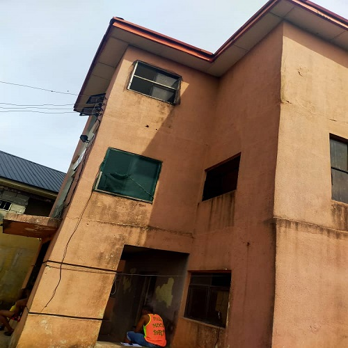 Two story building housing 49 Rooms Self contained Hostel  at Item street after Diamond Bank opposite God Knows Hostel for sale