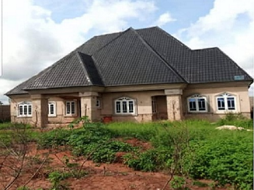 Uncompleted three bedrooms all ensuit bungalow situated on a Two and half plots of land at umuekwene, irete for sale